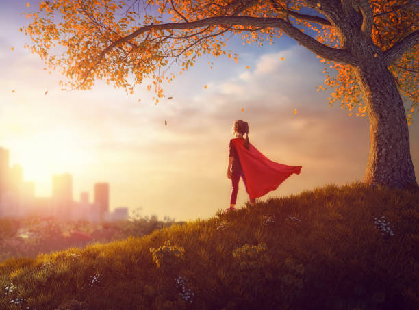 child is playing superhero - dreamlike stock photos and pictures