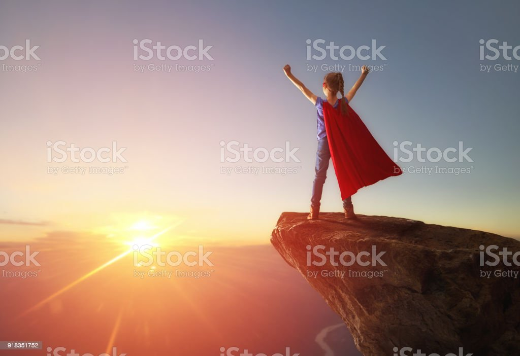 child is playing superhero royalty-free stock photo