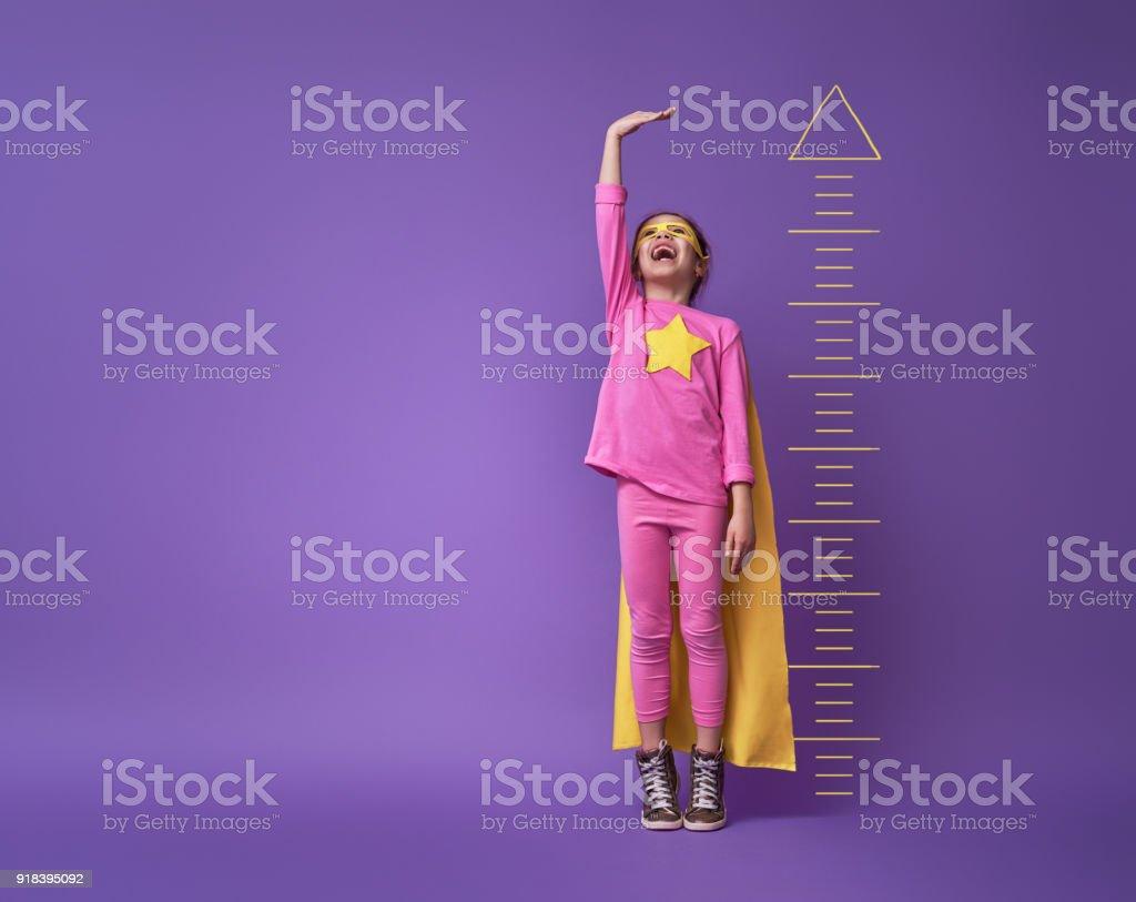 child is playing superhero stock photo