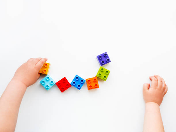 Child is playing with colorful constructor blocks kids hands with picture id1168993516?b=1&k=6&m=1168993516&s=612x612&w=0&h=jctw7og8reruxeq4p3xkxcxlcha7m5e3uy knvt7q w=