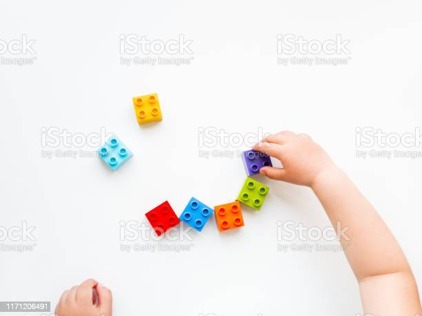 Child is playing with colorful constructor blocks kids hands with picture id1171206491?b=1&k=6&m=1171206491&s=612x612&h=tjldd9p6rq9s3macfymvfwltaepizv0xp tzyyygwjy=