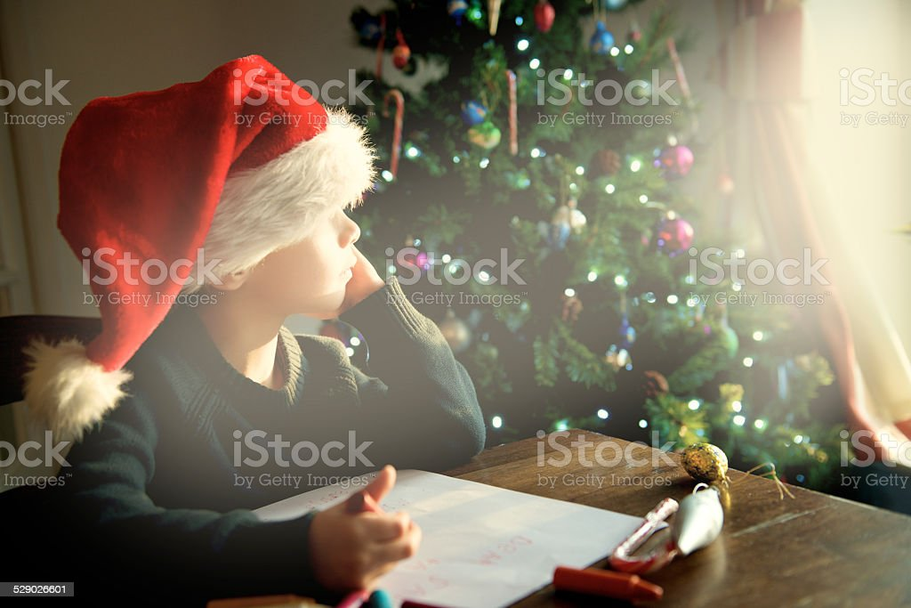 Child is waiting inspiration for Christmas letter stock photo