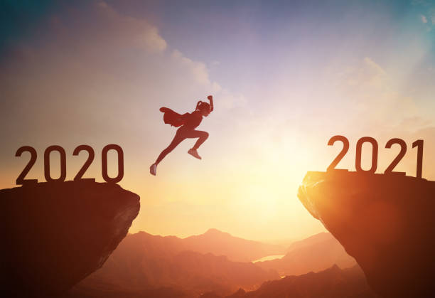child jumping between 2020 and 2021 stock photo