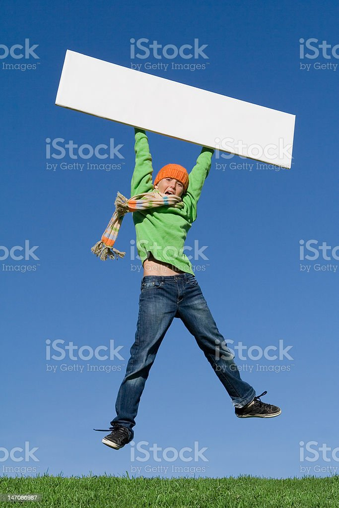 child jumping holding blank sign or banner royalty-free stock photo