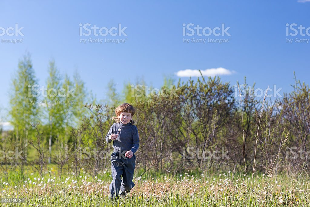 child jumping in a summer park. foto stock royalty-free
