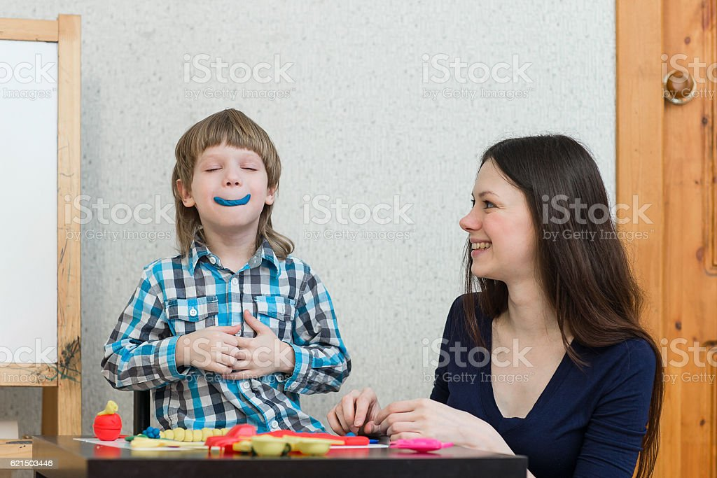 child kid boy and mother play colorful clay Lizenzfreies stock-foto