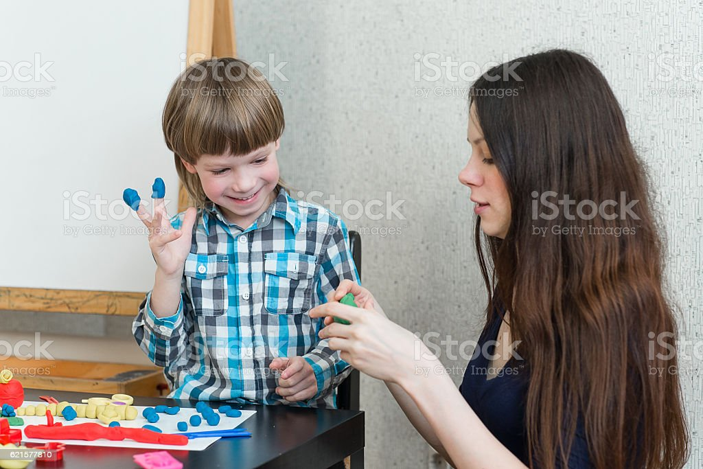 child kid boy and mother play colorful clay photo libre de droits