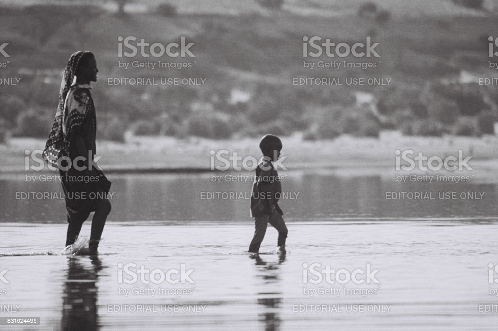 Child leading mother stock photo