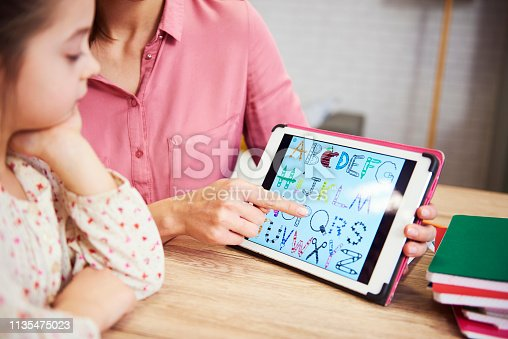 istock Child learning the alphabet on the tablet 1135475023