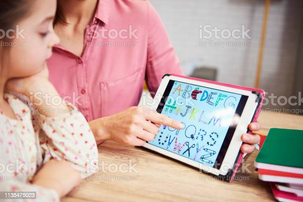 Child learning the alphabet on the tablet picture id1135475023?b=1&k=6&m=1135475023&s=612x612&h=qw4mnge0fal4tfetd67hpca4 ugyebljfdfb1rztzj0=