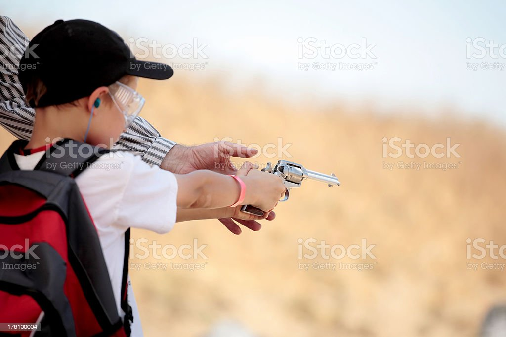 Child learning to shoot royalty-free stock photo