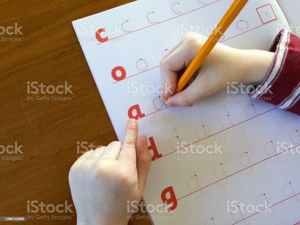 Child learning to write stock photo