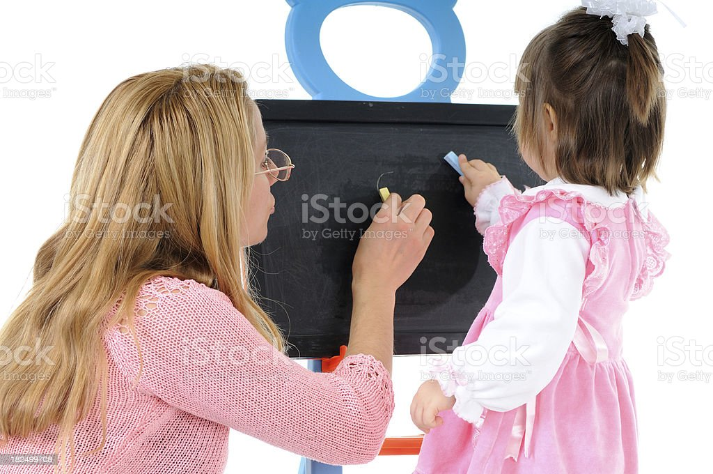 Child learns to draw royalty-free stock photo