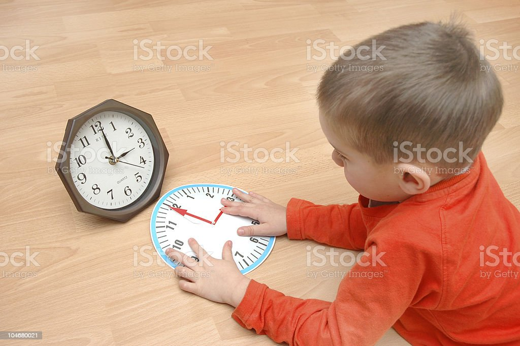 Child lears the time royalty-free stock photo