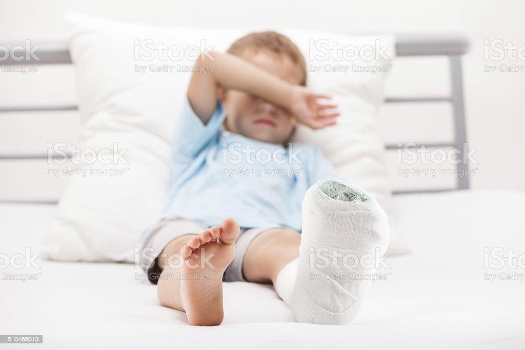 Child leg heel fracture or broken foot bone plaster bandage stock photo