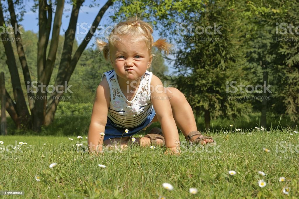 Child, little girl having fun on the meadow royalty-free stock photo