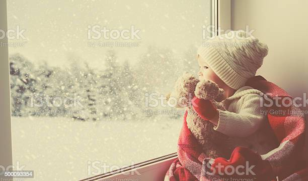 Child little girl with teddy bear at window winter picture id500093354?b=1&k=6&m=500093354&s=612x612&h=xygzaltu8uqp3m94 kencdpwcdkeoal36td w2d3p2e=