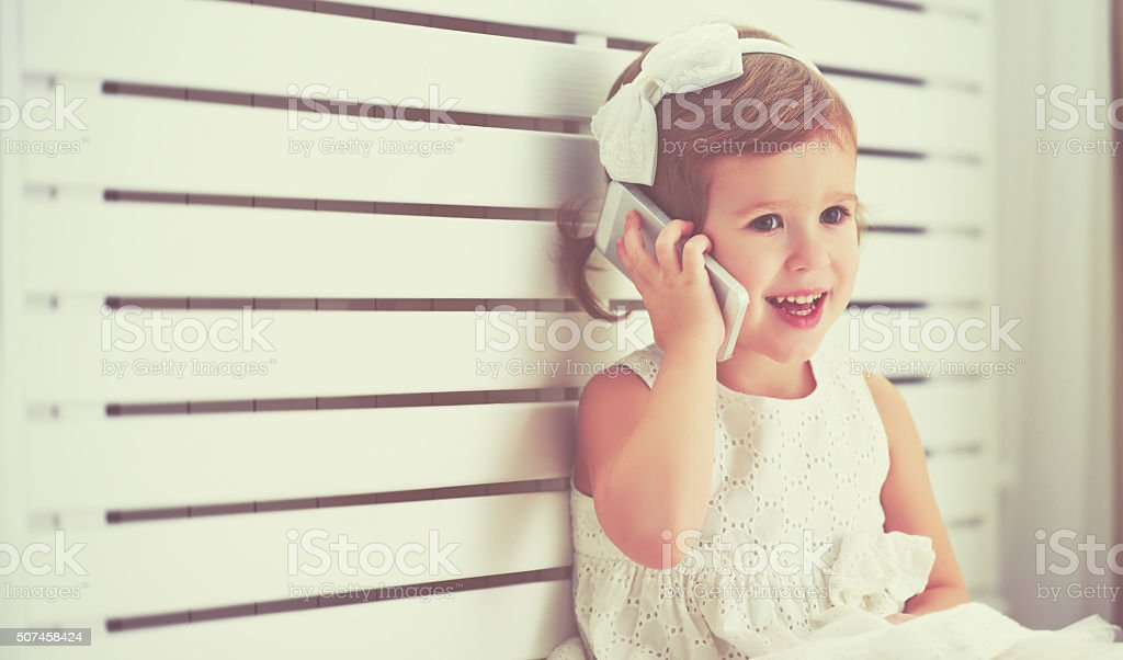 child little girl with  telephone smartphone stock photo