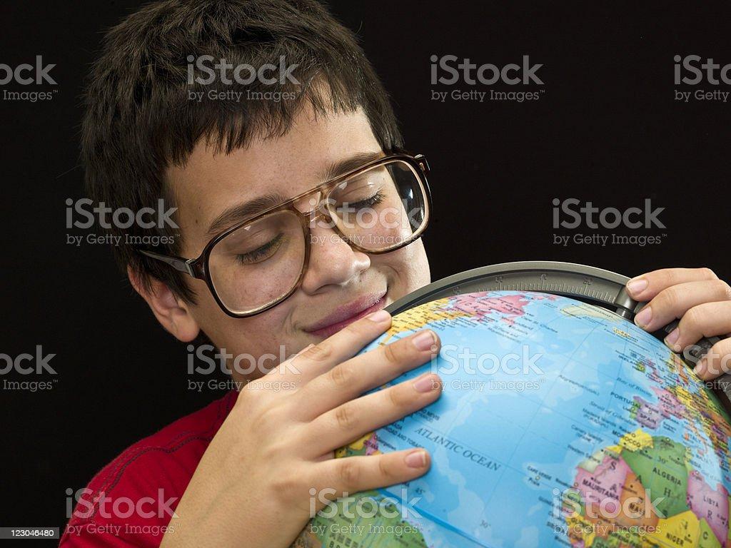 Child looking at an small desktop world globe