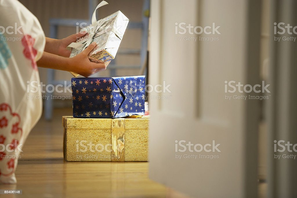 Child looking at Christmas gift royalty-free stock photo