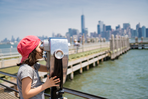 Child looking at panorama from Liberty Island