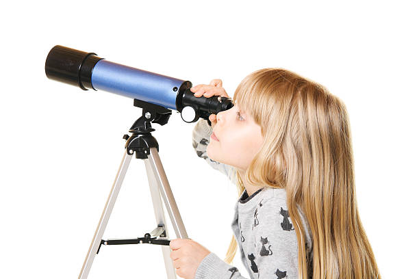 Child Looking Into Telescope Little Girl stock photo
