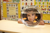 Child looking through a fish bowl