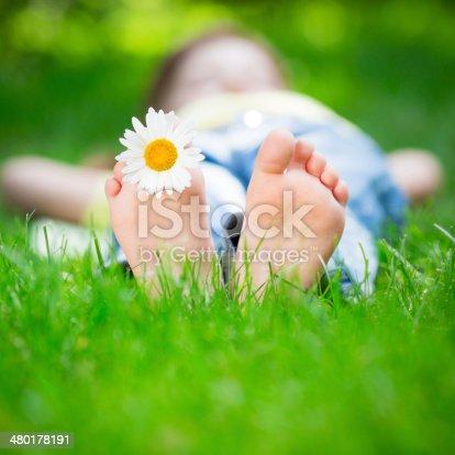 480122543 istock photo Child lying on grass 480178191