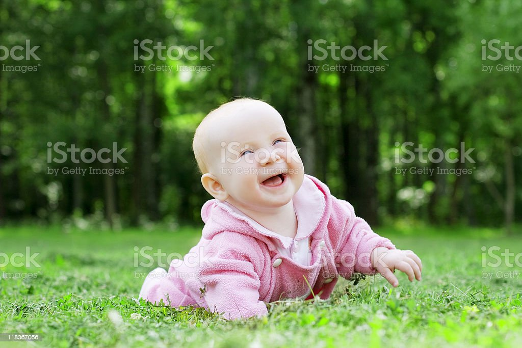 Child lying on the grass royalty-free stock photo