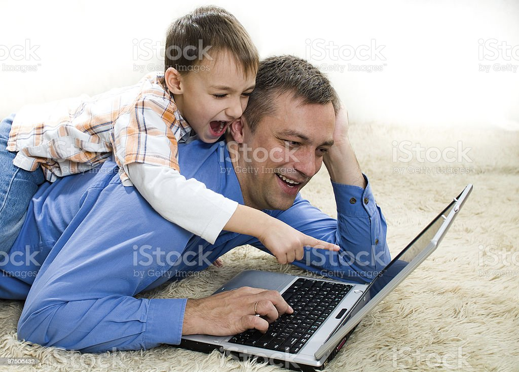 child lying  with his father royalty-free stock photo