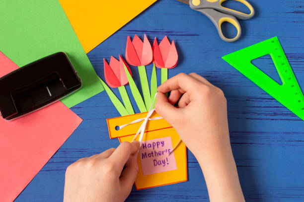 Child makes card for Mother's Day. Step 12 stock photo
