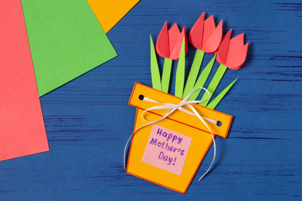 Child makes card for Mother's Day. Step 13 stock photo