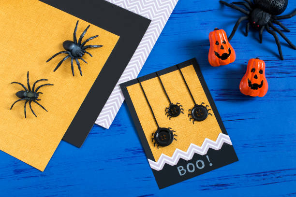Child makes card to Halloween. Step 8 stock photo