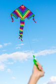 Child makes kite rise in autumn