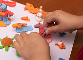 Child makes Unicorn from plasticine