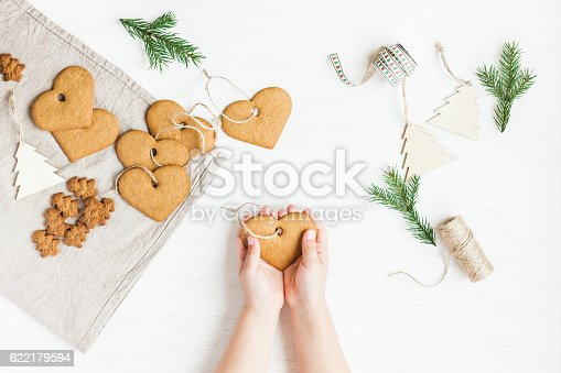 istock Child making christmas decorations from cookies. flat lay, top view 622179594