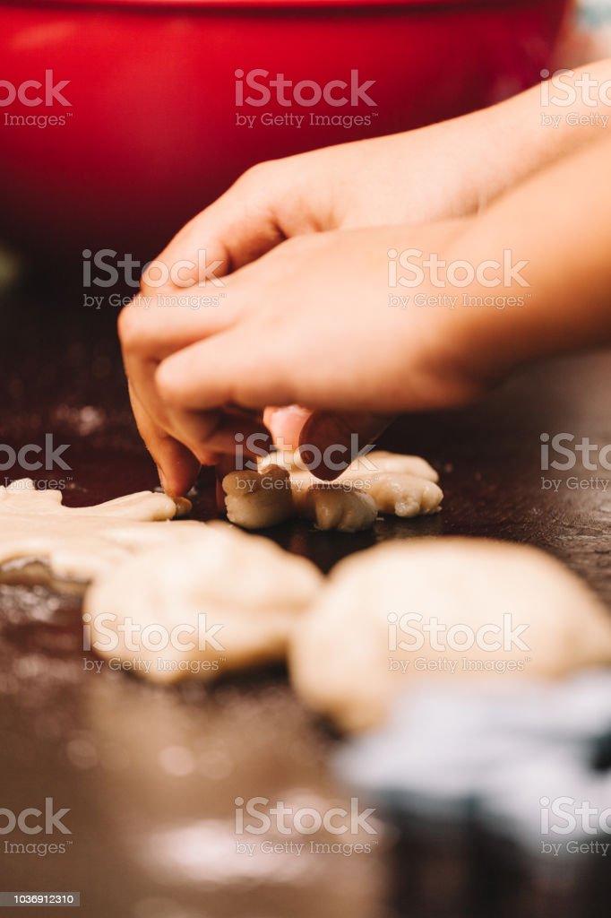 Child making cookies stock photo