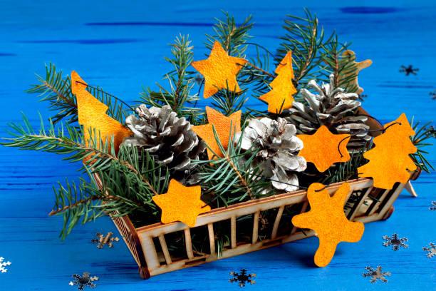 Child making decorations of orange peel for Christmas. Step 7 stock photo