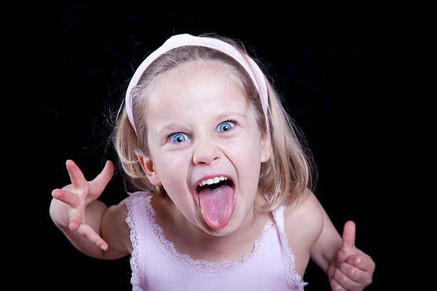 child making funny silly face - sticking out tongue stock photos and pictures