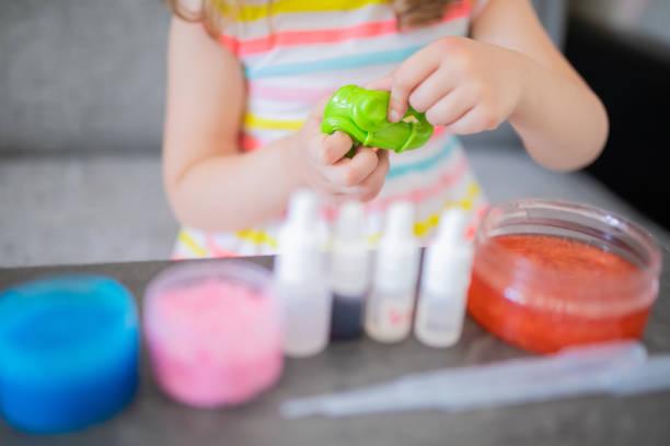 Child making slime closeup photo stock photo