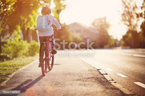 istock child on a bicycle 1044748302