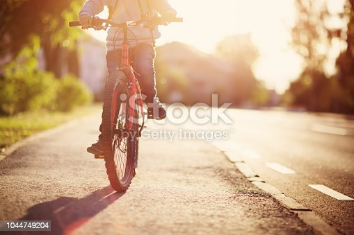 istock child on a bicycle 1044749204