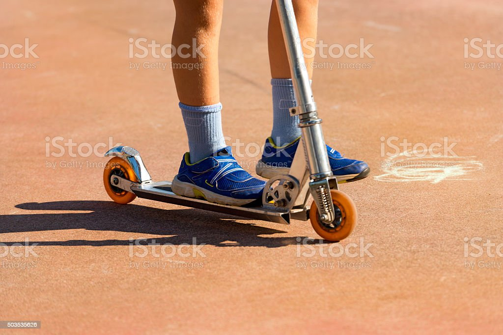 Child on a Scooter stock photo
