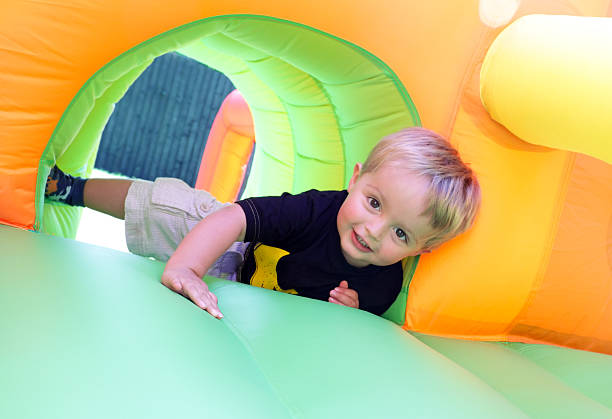 Child on bouncy castle stock photo