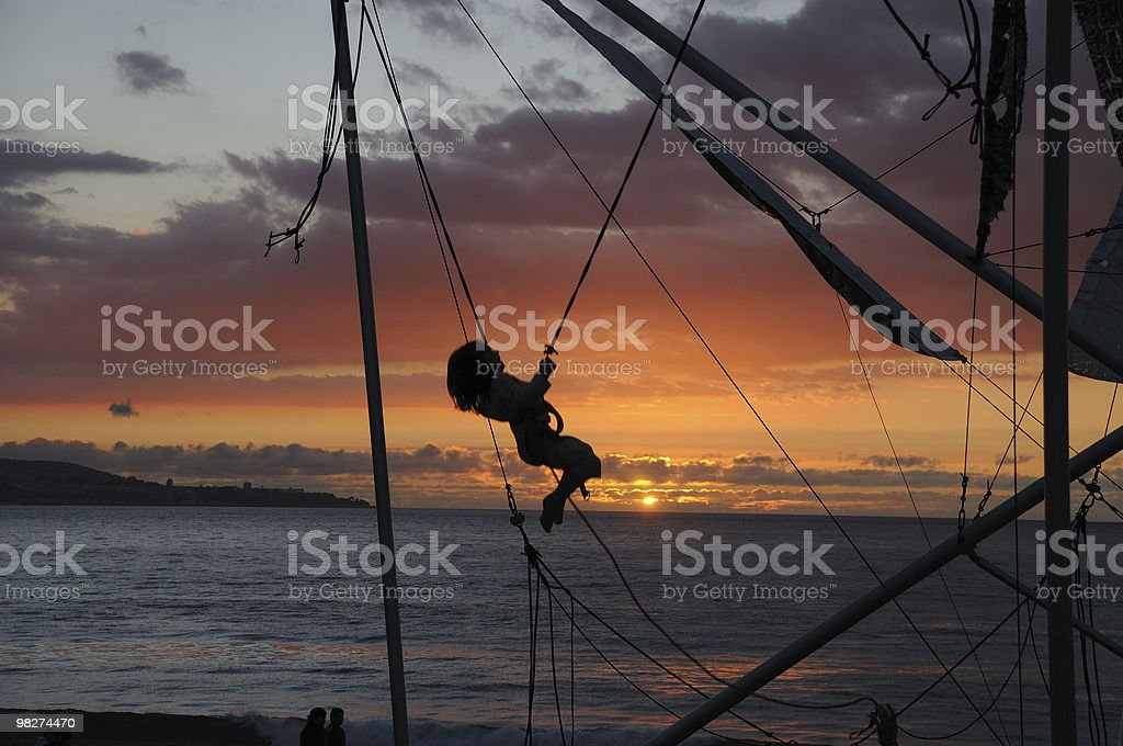 Child on Bungee Cord Swing royalty-free stock photo