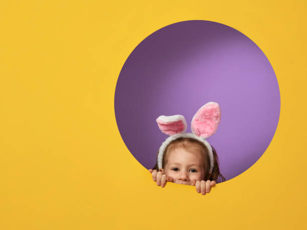 child on easter day - easter stock pictures, royalty-free photos & images