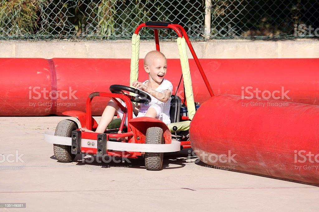 child on go cart stock photo