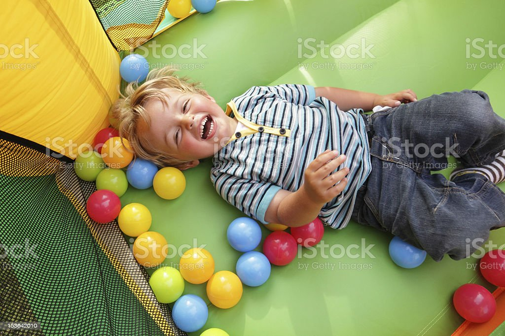Child on inflatable bouncy castle stock photo