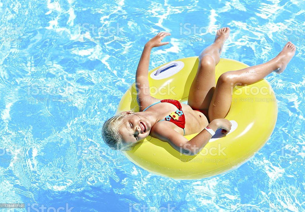 Child  on inflatable in swimming pool. royalty-free stock photo