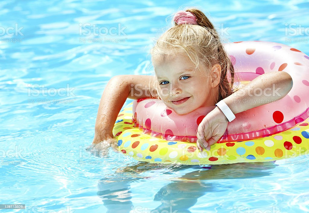 Child  on inflatable ring . royalty-free stock photo